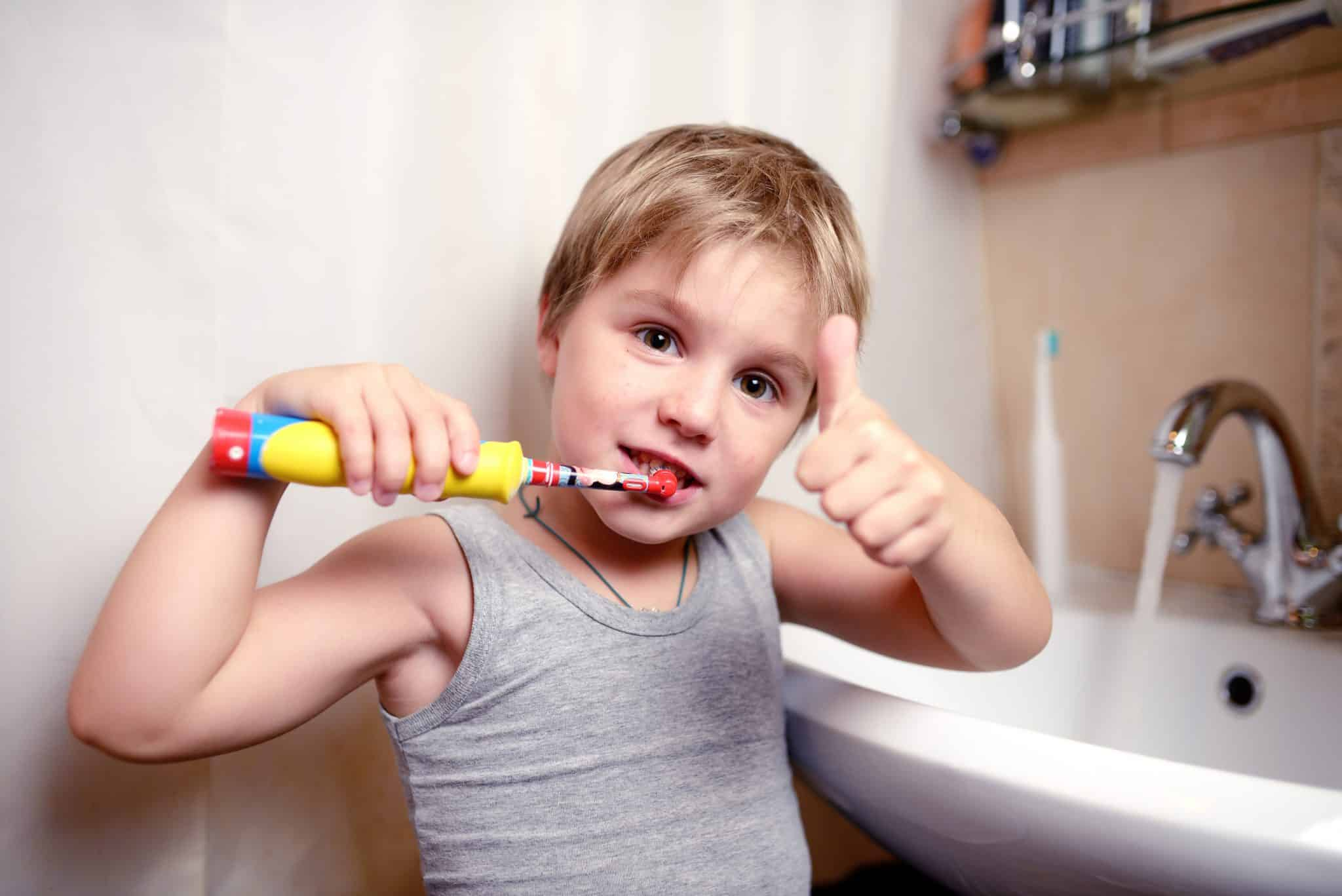 Child with electric toothbrush